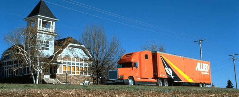Allied Truck driving in front of house