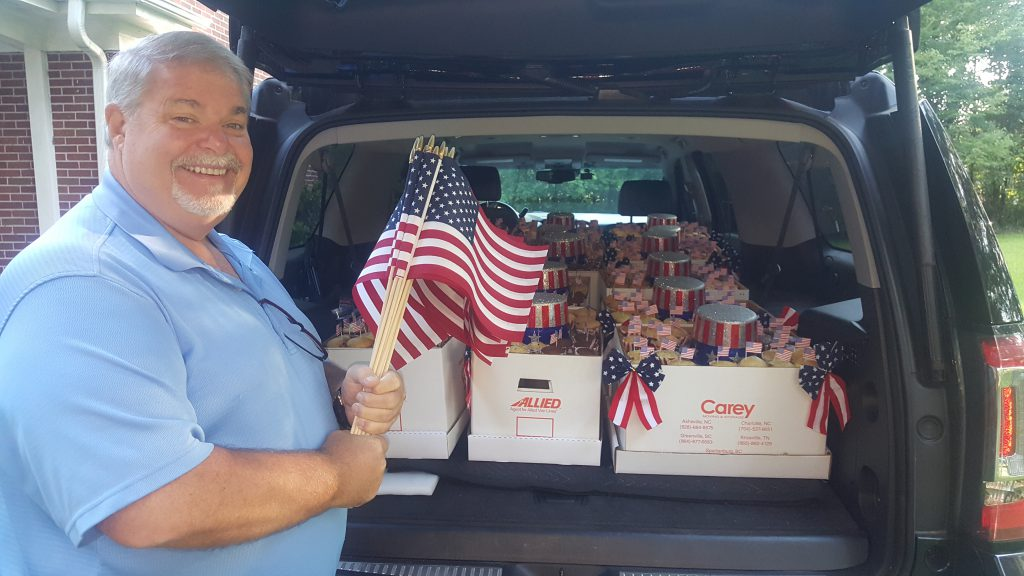 Carey delivers 4th of July treat to local realtors