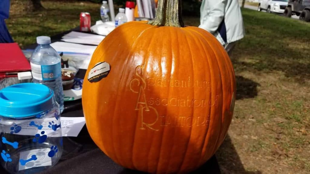Pumpkin with Spartanburg Association of Realtors carved into it